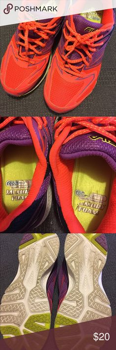 Women's Fila tennis shoes Wore these shoes three times! In great condition. Only place that's shoes any wear is bottoms of the shoes and a little on the heels on the souls. Great shoes just a little too small for me. Bright orange and purple! Fila Shoes Sneakers