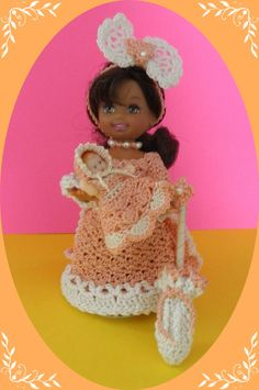 """This auction includes a hand crocheted with #10, #20 #30 crochet cotton dress, headband, necklace, parasol, baby doll with dress and hat to fit the 4 ½"""" Kelly doll and her same-sized friends created in a smoke-free home."""