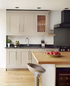 Hand painted in warm biscuit tones, this classic-style, framed kitchen has been paired with a stylish black range cooker Kitchen Paint, New Kitchen, Kitchen Cabinets, Kitchen Ideas, Kitchen Furniture, Kitchen Interior, Kitchen Design, Black Range Cooker, Bespoke Kitchens