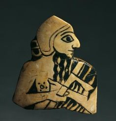"""Weapons from The Royal Tombs of Ur. This shell plaque is from the Royal Tombs of Ur. It is in the Baghdad Museum. Surprisingly, it is labeled simply as a """"human figurine"""", without any mention of it being a king."""