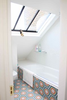 Loft conversion bathroom, A bathroom in a loft conversion can be quite tricky but using the roof as a window opens up the space and draws attention away from the the sloping roof and small space