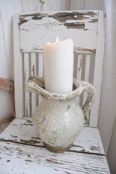 Old pitcher now candle holder