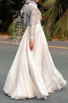 This is exactly what I desire in a wedding down: sheath silhouette, court train, high neckline, and long sleeves.