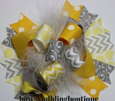 "I love this super cute yellow and grey hair bow! The bow is layered with vibrant colors and beautiful ribbon. Each bow pictured measures approximately 5""-5.5"" across. It is perfect for babies, toddler"