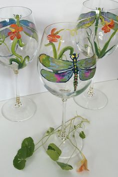 Each glass is hand painted with special care, attention, and love of painting by Gretchen, a trained fine artist. My glasses are like little paintings for your home, transforming your table scape from ordinary to extraordinary!  The wine glass has become another canvas for my love of looking and painting ! Whenever possible I paint from life, keeping my studio here in Chester County, Pennsylvania full of real flowers and fruits for reference. I also use vintage botanical drawings for…