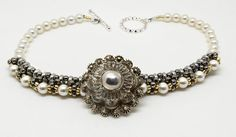 Ornate Silver Centered Button Bracelet – A #vintage layered ornate #button with centered silver bead. Set on bracelet of white @swarovski pearl beads with silver, gunmetal & gold bead accents. Sterling toggle closure. #ButtonDesignCo #jewelry #bracelet