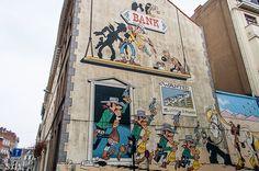 Bruselas y su ruta del Comic. Mural de Lucky Lucke. http://anden-27.blogspot.com.es/2014/10/ruta-del-comic-en-bruselas.html