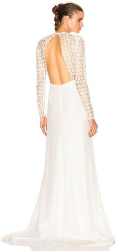 Self-Portrait's Eva Backless Silk Wedding Dress transcends time with a traditional A-line cut juxtaposed by modern feminine touches. An intricate lace pattern climbs down the sleeves and along the bodice to reveal a captivating open-back.  affiliate link