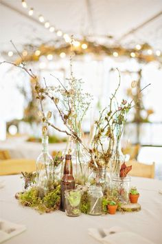 rustic country mossy branches wedding centerpiece / http://www.deerpearlflowers.com/wine-bottle-vineyard-wedding-decor-ideas/