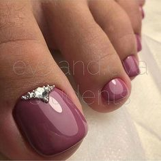 Maroon pedicure with gem accent