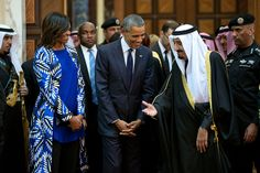 President Barack Obama and First Lady Michelle Obama walk with King Salman bin Abdulaziz of Saudi Arabia at Erga Palace in Riyadh, Saudi Arabia, Jan. 27, 2015. Official White House Photo by Pete Souza/ flickr