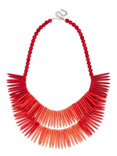 This big, double-layered statement of ombré coral-colored fringe and colored beads is especially gorgeous when its beachy, tribal vibe is toned down with structured separates.