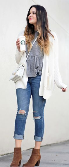 Okay, need to copy this look ASAP | Fashion blogger Mash Elle styles an everyday casual outfit comprising of Express ripped cropped skinny jeans, Sam Edelman booties, Urban Outfitters Oversized Chunky Knit Sweater, grey peplum top/dress, Vera Bradley white leather cross body, crystal choker and MAC lipstick.