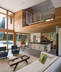 Love the wood and the floor to ceiling glass.