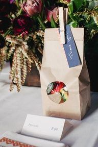 paper bags with goodies for the guests // photo by Louisa Bailey