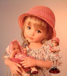 The faces on these dolls are beautiful.  By Dianna Effner