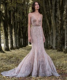 Just one of the many beauties from Paolo Sebastian's Gilded Wings collection, this fishtail wedding dress is a real treat. The shimmery metallic colours are so enchanting and will help any bride pull off a really glamorous look. We love wedding dresses with plunging necklines, they are perfect for brides who dare to go low and this is one of the best we've seen.