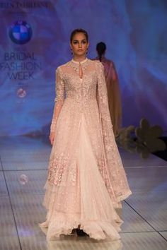 Tarun Tahiliani cream anarkali jacket lehnga. More here: http://www.indianweddingsite.com/bmw-india-bridal-fashion-week-ibfw-2014-tarun-tahiliani-show/