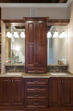 on vanity bathroom towers | traditional bathroom by Lifestyle Builders & Developers, Inc.