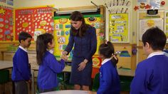 I don't know why Kate Middleton insists on clutching her hand to her crotch while shaking kids' hands. But she does.  Still from a video Kate made for Children's Mental Health Week 2016.