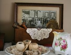 family heirloom display- gma's dolie with  a picture of her?