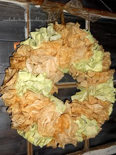 Painted/tea stained coffee filter wreath...It reminds me of Hydrangea.