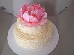 Wedding cake with ruffles and gumpaste flower on top