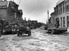 Polish tanks advancing through battle torn Dutch town of Moerdijk which guards the approaches to two bridges spanning the lower Rhine.