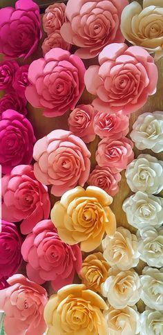 our beautiful new Koko roses in tiny mini and small ...#ombrepaperflower display at a trade show  #paperflower check out our #etsy shop for templates ...love these!!  #roses #paperroses #photowall #backdrop #photobackdrop #wedding #weddingflowers