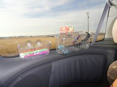 Moser Moments: Surviving a road trip with kids. Removable shower baskets on the window to hold kid's stuff on road trips