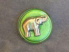 "Elephant button. Green glass button w/ silver elephant. 1 3/8"" (34mm) 1 pc."
