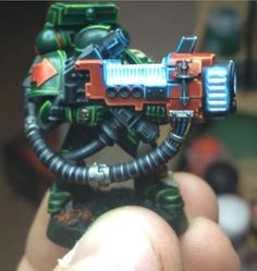 Warhammer 40K Marine with Plasma Weapon.  That fluorescent lighting you see was not done with little LEDs installed as one friend guessed.  That is in fact the paint job.  White and Blue was the primary colours, but the application of the white was what really made it work.  Even the blue 'reflecting; off his helmet is a painted on optical illusion.