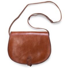 A functional leather saddlebag perfect for someone on the go. Handmade of Moroccan leather by Berber artisans in North Africa.