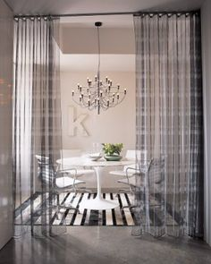 Interior draperies were used to set off this Dining room in a Boston loft by designer Kelly Monahan.