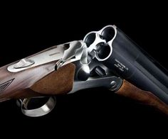 """Triple Barrel Shotgun - For extra zombie stopping power or just a backup shot for the Double-Tap, Zombieland style.  Chiappa introduced two 12-gauge triple barrel shotguns. Both have """"Rem-choke"""" and a 3"""" x 3"""" Magnum capacity, but the Triple Crown boasts three 28"""" barrels, while the Triple Threat's measure 18-1/2"""". The Threat also includes a wooden stock that can be partly disassembled."""