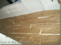 Paper bag flooring that looks like wood! Amazing and C H E A P.