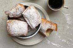 Basically just little fried pillows of dough, beignets may look tricky, but trust us: this recipe—which calls for few ingredients and doesn't require kneading—is one that any cook can master. Be warned, however: the dough is supposed to be quite sticky (it's moisture that helps the fritters rise up nice and airy), so make sure to generously flour your work surface and your rolling pin.