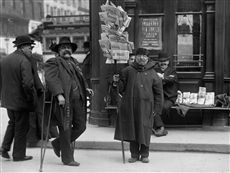 France. Selling newspapers on street in front of the Stock Market, Paris, 1903.