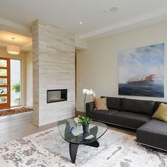 Floating fireplace- trim up our current fireplace, replace old with two sided gas insert