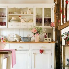Cut clutter and get your kitchen under control with a pretty yet functional dresser like the one in this cosy space