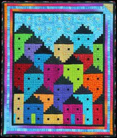 """Rainbow City. 42"""" X 50"""" Traditional Log Cabin Machine pieced, handquilted Cottons ©2014 Flavin Glover"""