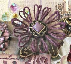 Update March 2016: I now have a video tutorial for Girlie Grunge Twine Flowers showing how to create the loom and twine flower using Donna...