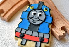 Choo! Choo! Chew! Party-goers will be on board for these custom-shape Thomas cookies. http://www.thomastrainrides.com/fun-and-games.html#14may15