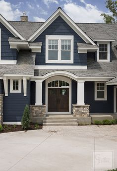 Color Navy exterior paint color with white trim. Navy exterior paint color is Benjamin Moore Hale Navy. Navy exterior white trim home ideas. Navy homes. Navy home Ideas. Navy home white trim paint color ideas. Design Exterior, House Paint Exterior, Exterior House Colors, Blue House Exteriors, Exterior Paint Ideas, Exterior Paint Colors For House With Stone, Craftsman Home Exterior, Exterior Decoration, Rustic Exterior