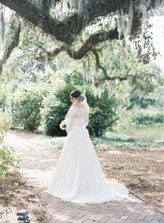 Classic lace three quarter sleeve wedding gown:  http://www.stylemepretty.com/alabama-weddings/2016/09/28/the-sweetest-bayside-wedding-ever/ Photography: Jessica Lorren - http://www.jessicalorren.com/