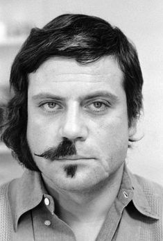 Oliver Reed, mid-haircut when filming The Devils.