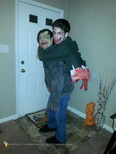 Awesome Zombie Carrying a Torn Gut Hanging Zombie Illusion Costume... Coolest Homemade Costumes