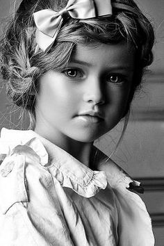 What a beautiful child! I hope she has a normal life and isn't exploited for her beauty.