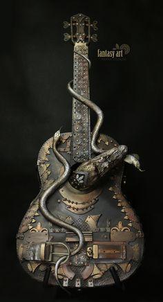 guitar fantasy steampunk_Zdenka Otipkova Steampunk Guitar, Steampunk Theme, Guitar Art, Cool Guitar, Custom Electric Guitars, Unique Guitars, Junk Art, Guitar Design, Instruments