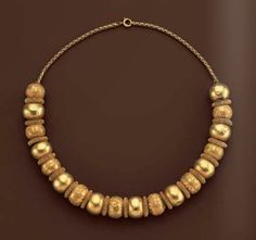 Beads of a necklace, Etruscan, 6th century B.C. (restrung on modern gold chain)